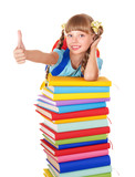 Schoolgirl with pile of books and showing thumb up.