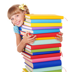 Schoolgirl with backpack holding pile of books.