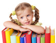 Child holding pile of books.  Isolated.
