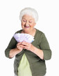 Happy woman holding currency notes against white background