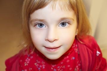 blond little girl portrait close up crop