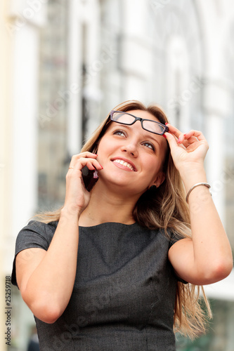 beautiful young businesswoman talking by mobile phone