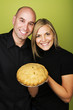 Couple holding pie