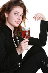 Charming girl with a wine glass