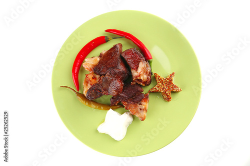 roast meat chunks on green plate
