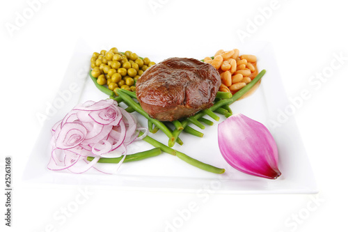 roast meat medalion on beans