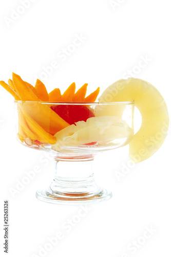 fruits within transparent cup