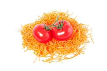 colorful grated carrots and two tomatoes isolated over white