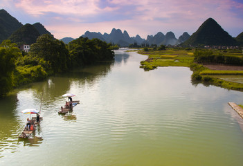 Bamboo Rafts drift down the Yulong River in Yangshuo, China