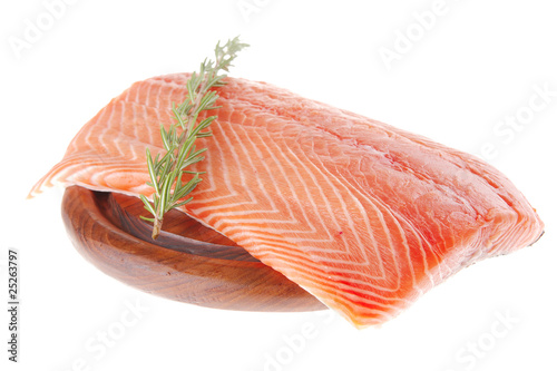 salmon fillet on wood plate and rosemary