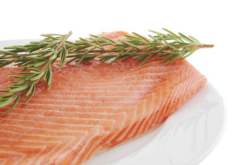 big salmon fillet on white with rosemary