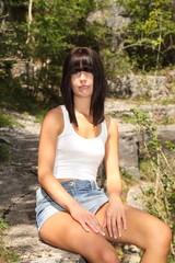 Cute teenage girl sitting in the sun