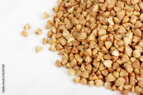 Buckwheat seeds closeup isolated on white