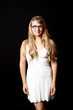 Pretty woman with eyeglasses in a white dress