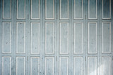 Faded blue-grey wooden shutters