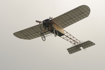 Vintage aircraft Bleriot XI in the air.