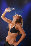 Thirsty woman drinks spring bottled water poster
