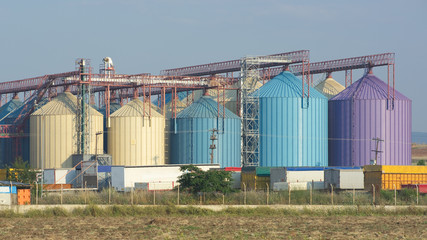 row of multi colored silos