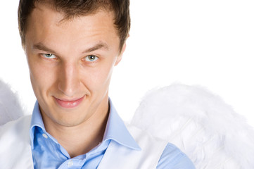 Close-up of a young man with the wings of angel