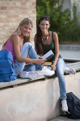 Happy female student students outdoors