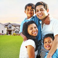 Happy Family Embracing in Front of House