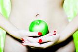 Woman Abdomen holding an apple poster