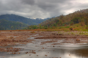 view of a drying river bed in hdr