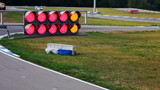 Traffic light on carting race sequence shot poster