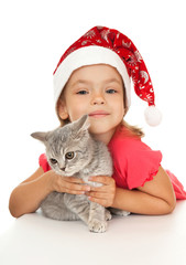 Little girl in New Year's cap with a kitten.