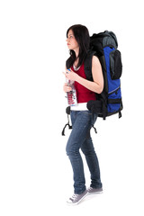 female tourist with backpack and bottle of water .