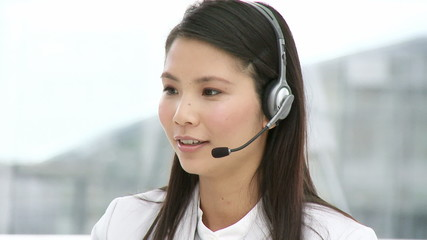 woman  with headset on working in a call center