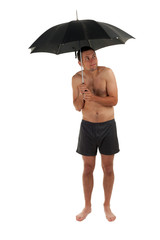 nude young man standing, keeping black umbrella