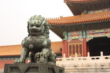 Bronze lion is guarding Forbidden City in Beijing, China