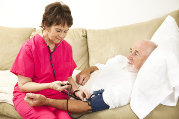 Home Nurse Takes Blood Pressure