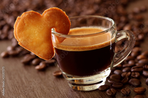 Espresso coffee with cake on brown background
