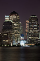 Financial District Manhattan at Night over Hudson river
