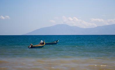 2 fishing boats floating at sea