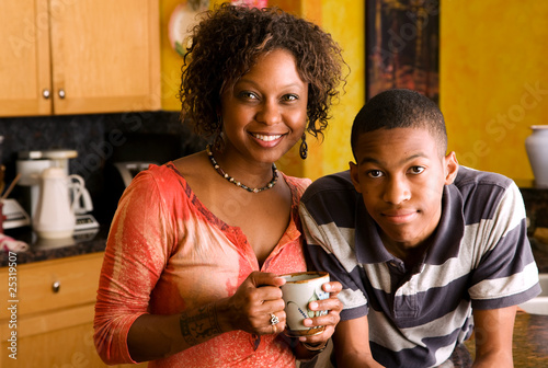 African-American family members in kitchen