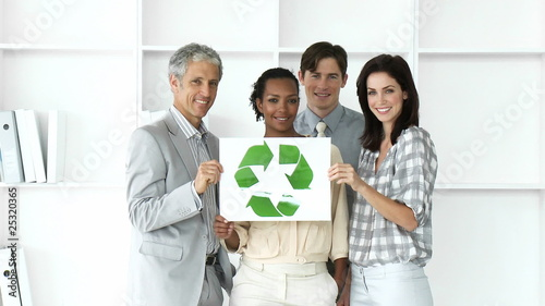 Self-assured business team showing the concept of recycling