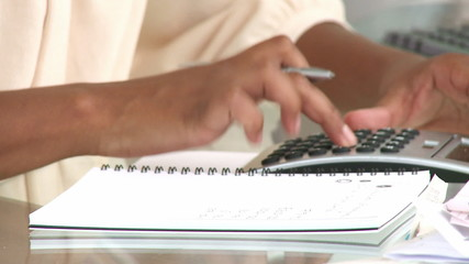 close-up of an african woman using a calculator