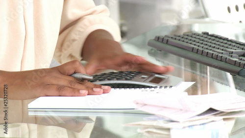 close-up of an afican woman doing her accounts