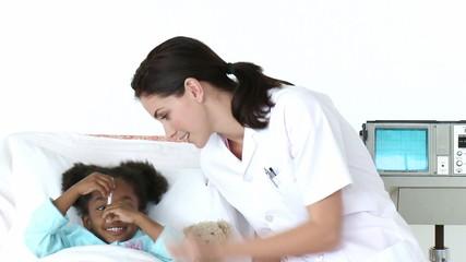 nurse taking cute girl's temperature