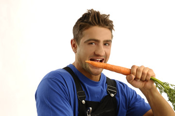 Young worker eating carrot