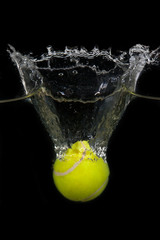Tennis ball dropped into water