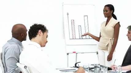 elegant businesswoman reporting graphs to her team