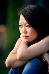 Young asian woman portrait, natural blurred background