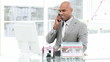 assertive african men on phone in his office