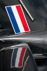 netherlands flag and reflection on an aircraft panel