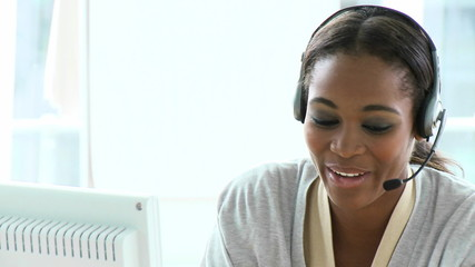 beautiful woman with headset on in a call center