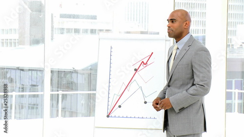 african businessman reporting figures to his team